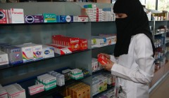 A female Saudi pharmacist works at the International Medical Center in Jeddah