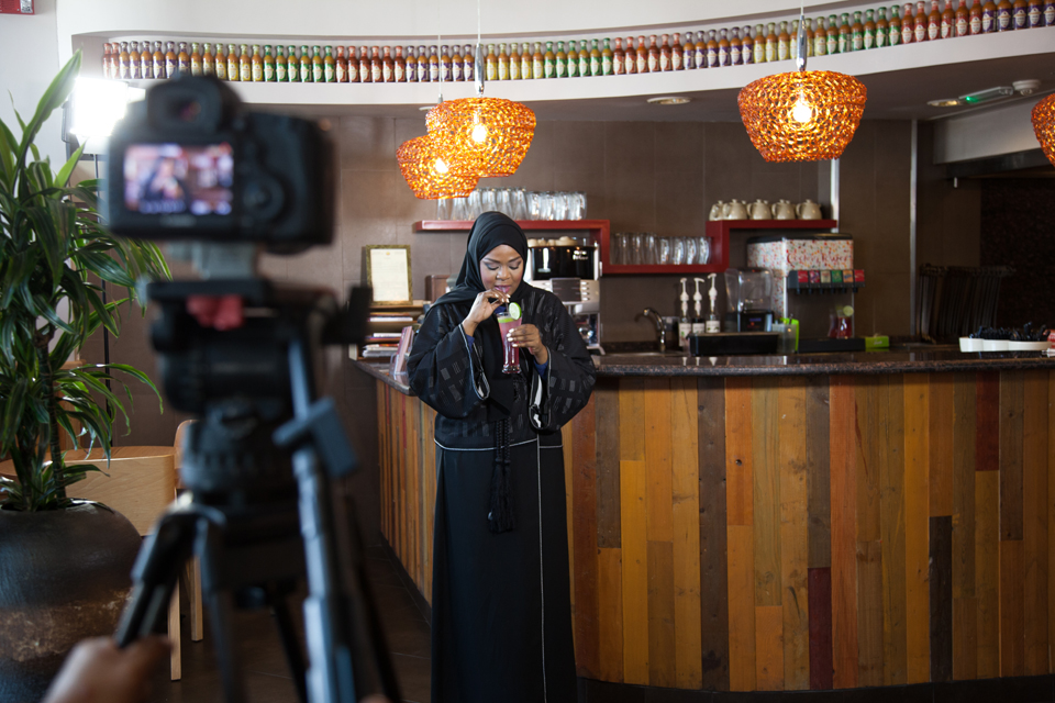 QTV presenter Hanadi Hassan takes a sip of the breast cancer awareness drink she is promoting at Nando's restaurant. Christina Paschyn, 2013.