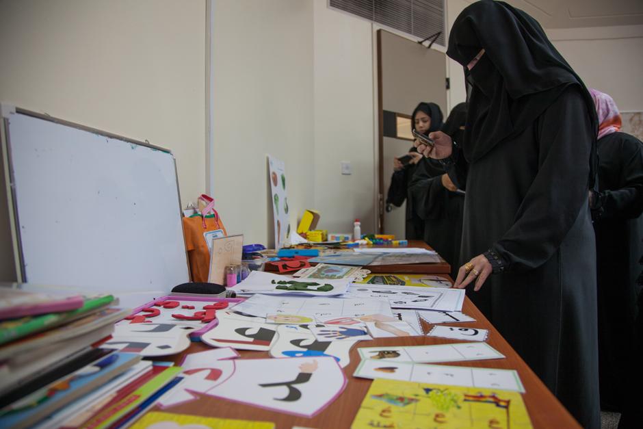 Qatari teachers review instructional materials (Christina Paschyn).