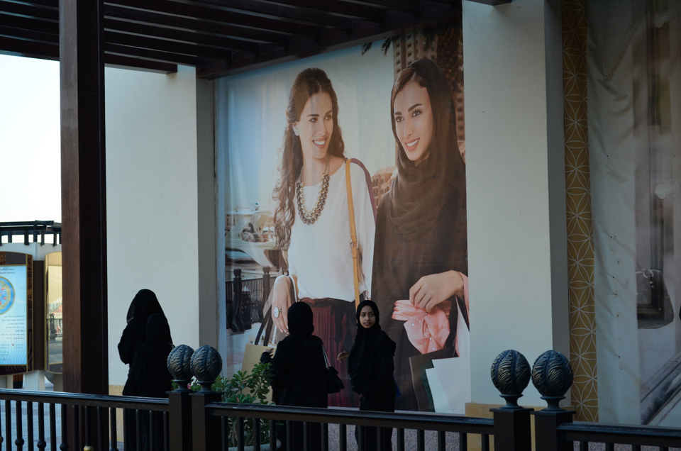 Posters at the luxury retail and residential development The Pearl-Qatar feature foreign Arab models dressed up as Qatari women instead. Photo by Christina Paschyn, 2013.
